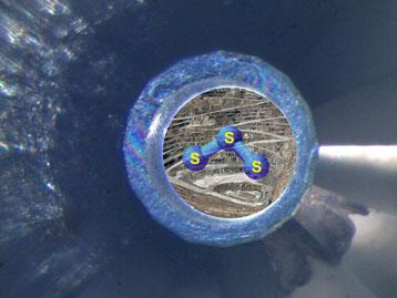 Impresión artística de la S3-molécula en una celda de yunque de diamante