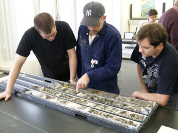 Members of the team examining coral samples.